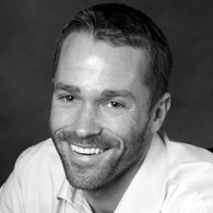Black and white photo of consultant Adam Sobieski