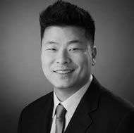 Black and white photo of consultant Justin Kim