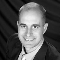 Black and white photo of consultant Tony Carlston