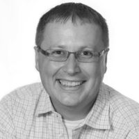 Black and white photo of consultant Curtis Jaques