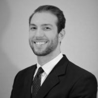 Black and white photo of consultant Aaron Swintek