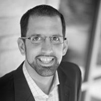 Black and white photo of consultant Josh Mueller