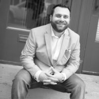 Black and white photo of consultant Aaron Ludin