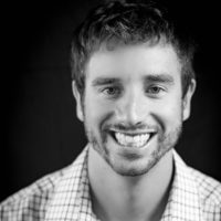 Black and white photo of consultant Adam Conroy
