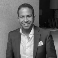 Black and white photo of consultant Andy Jeanty