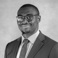 Black and white photo of consultant Lucky Odiase