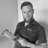 Black and white photo of consultant Joshua Rasizer