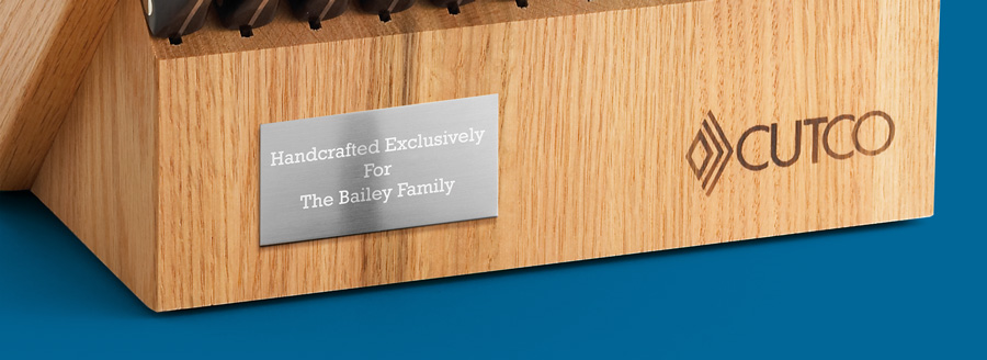 Engraved silver plate affixed to wood with the phrase Handcrafted Exclusively for The Bailey Family
