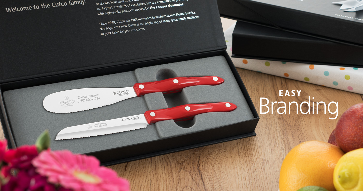 Two knives in gift box, engraved with business contact details.