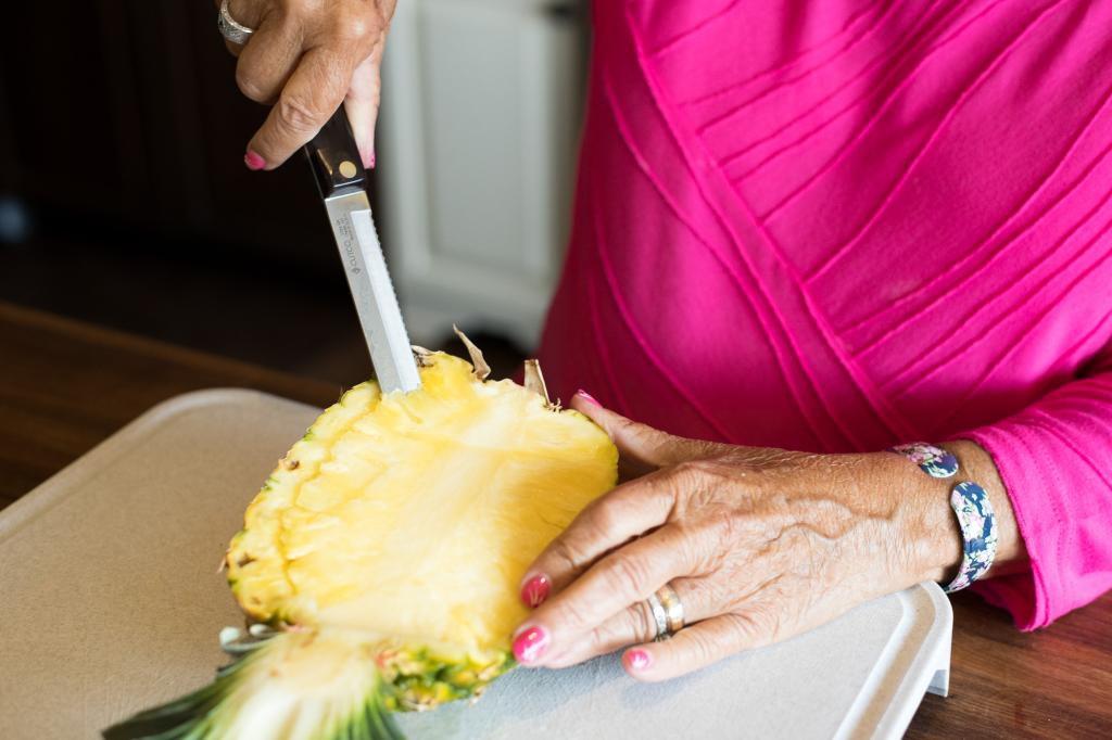 Slicing the interior of the pineapple.