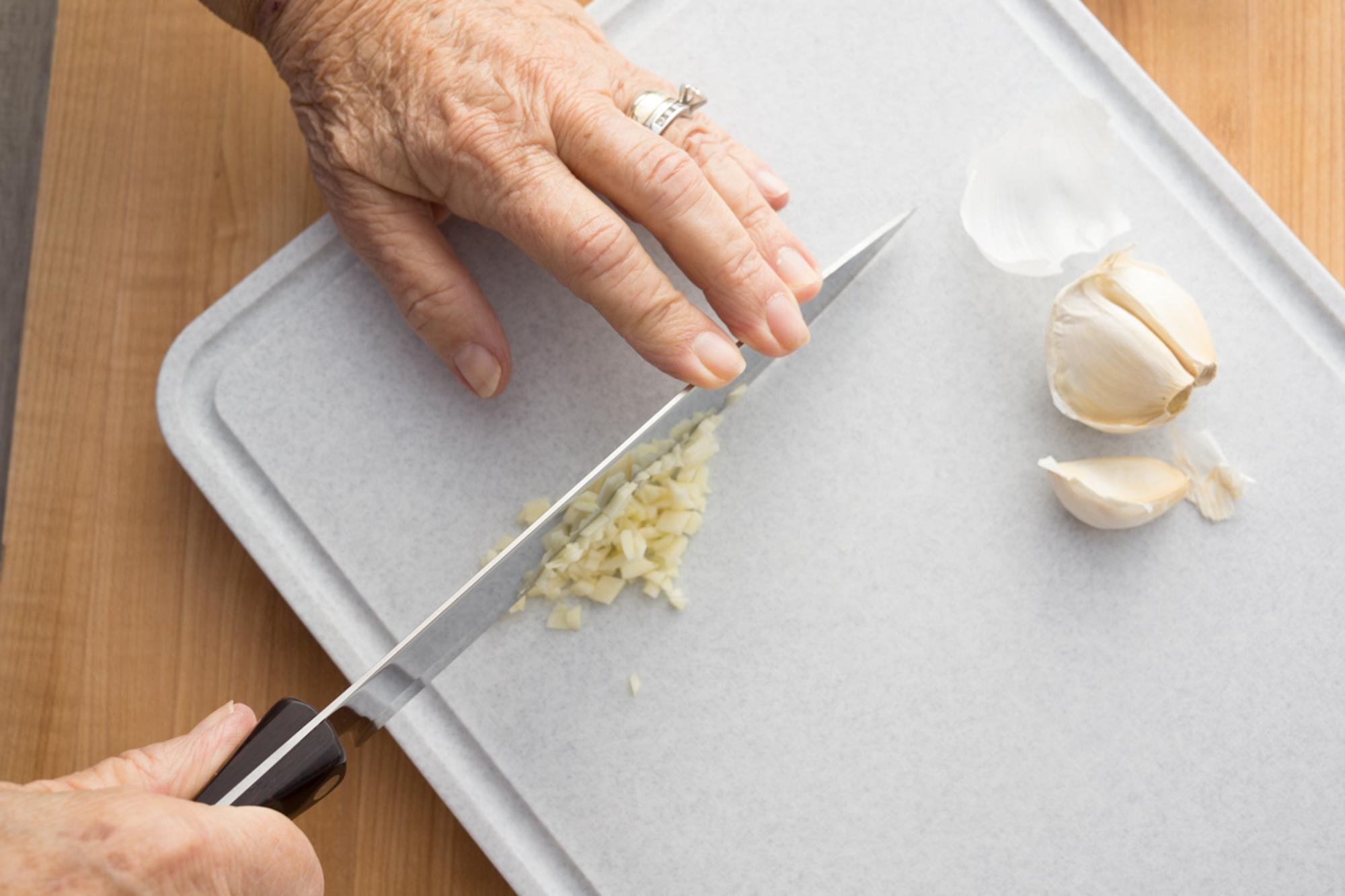 Mincing garlic with a Petite Chef.