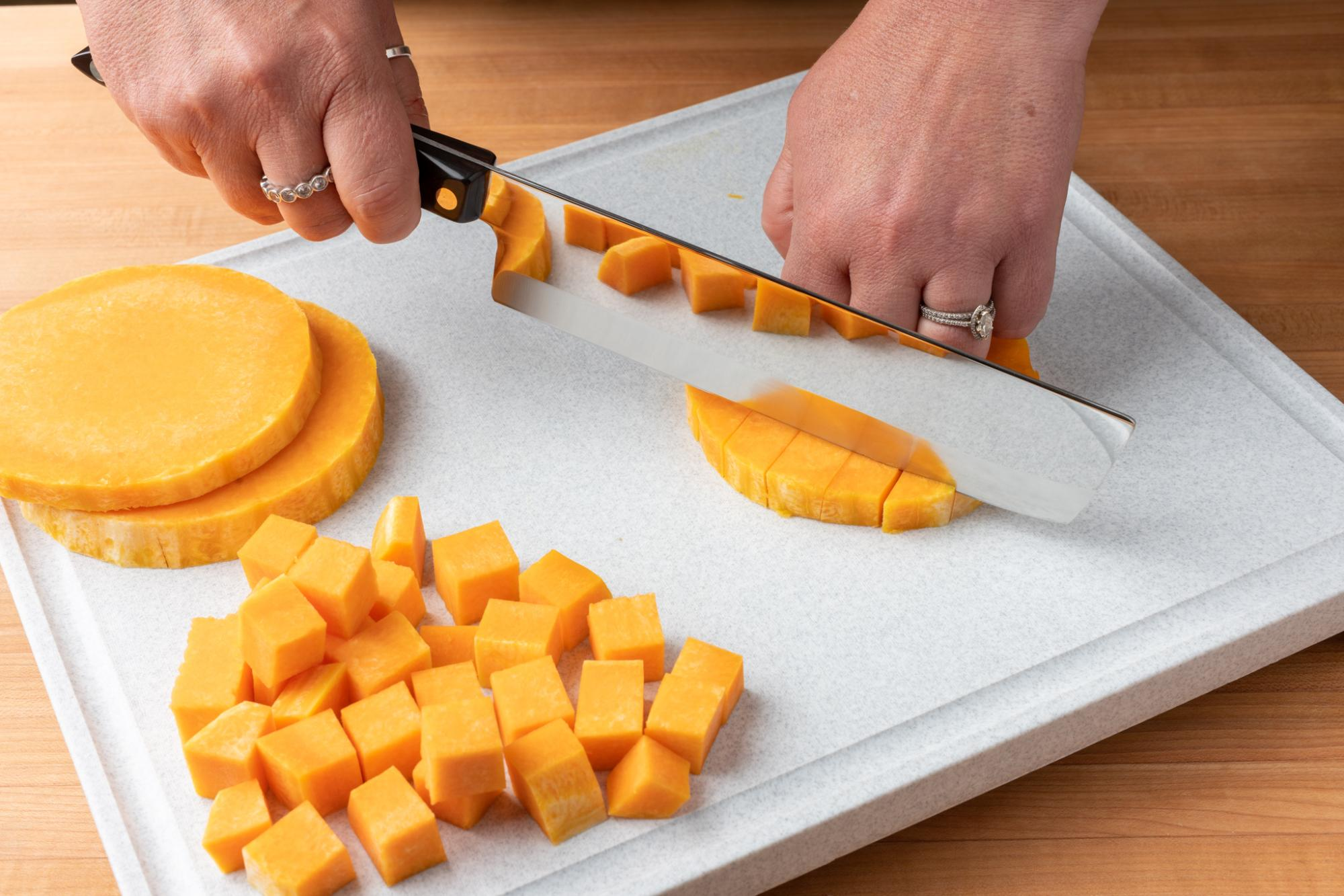 Dicing the butternut squash with a Vegetable Knife.