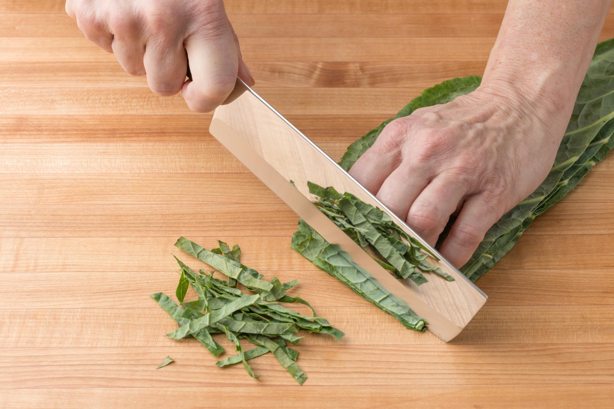 Slicing collard greens with a Vegetable Knife.