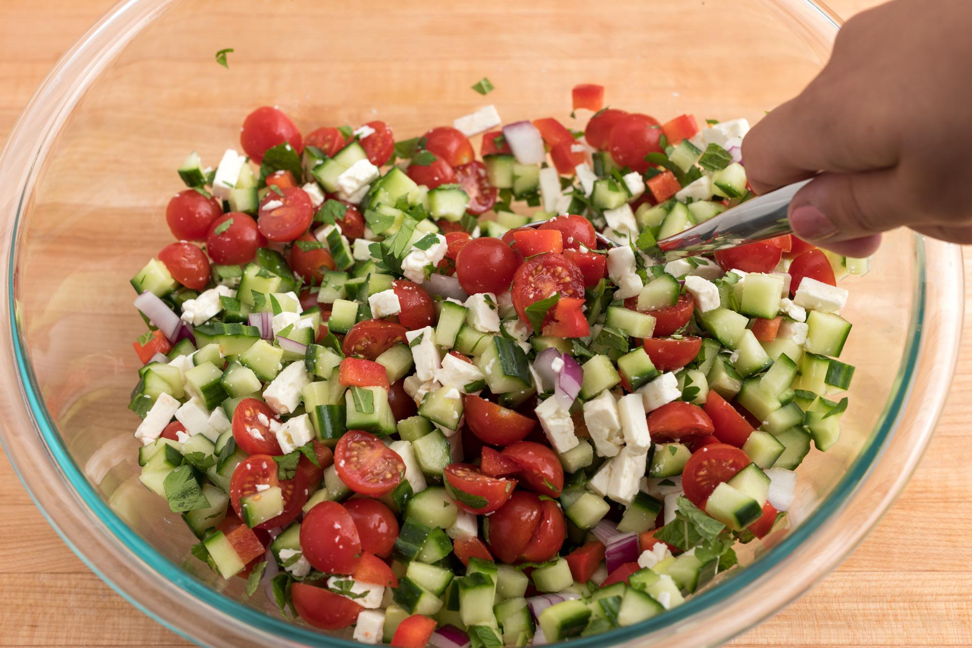 Mixing the salad.