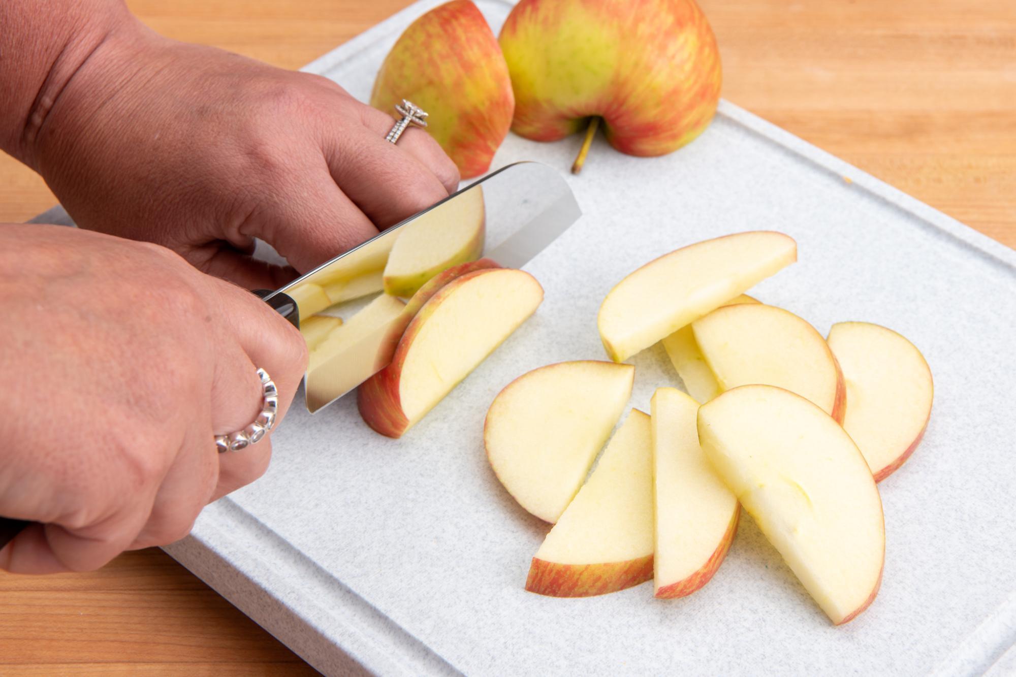 Using the Petite Santoku to slice the apples.