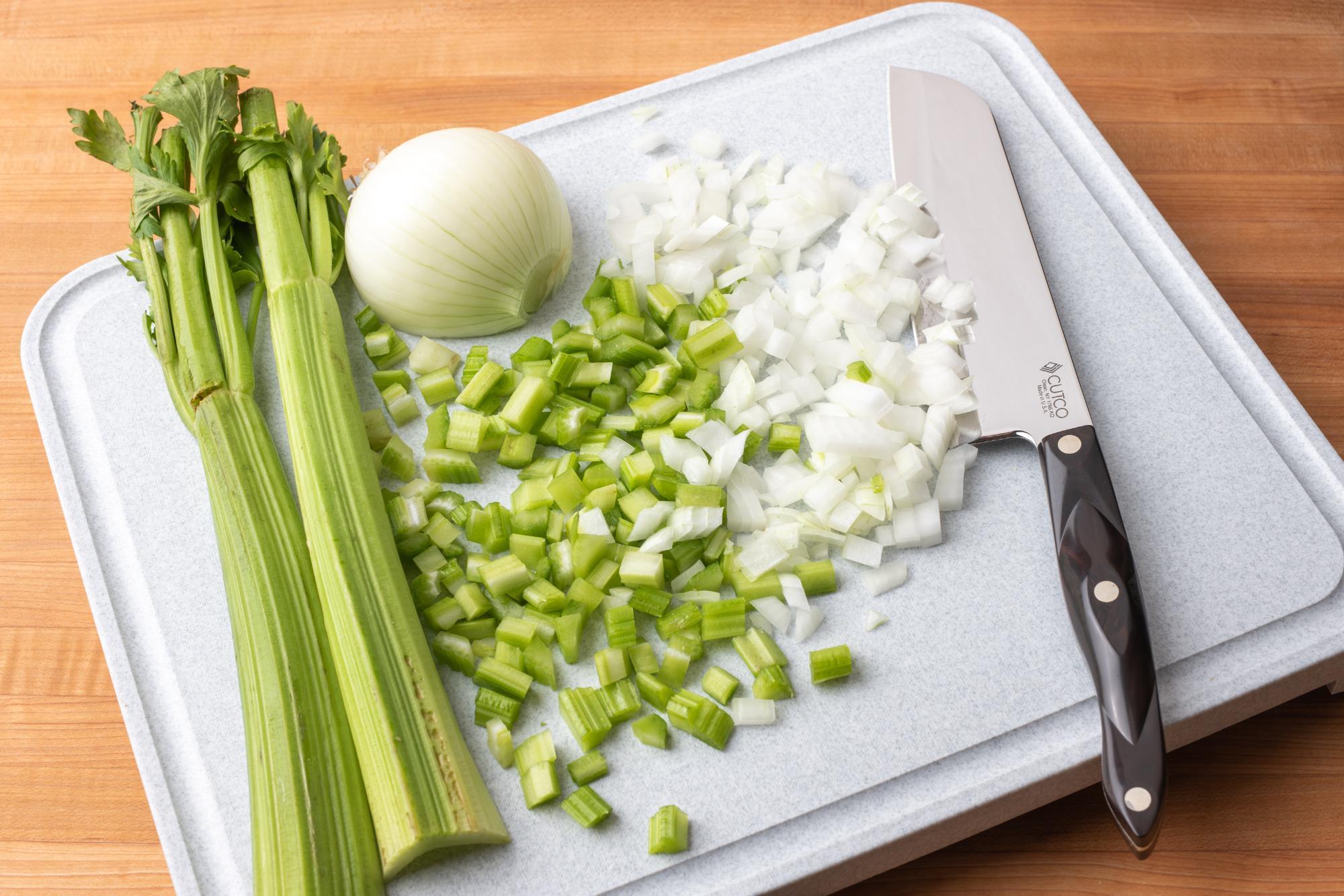 Diced celery and onion with a Santoku knife.