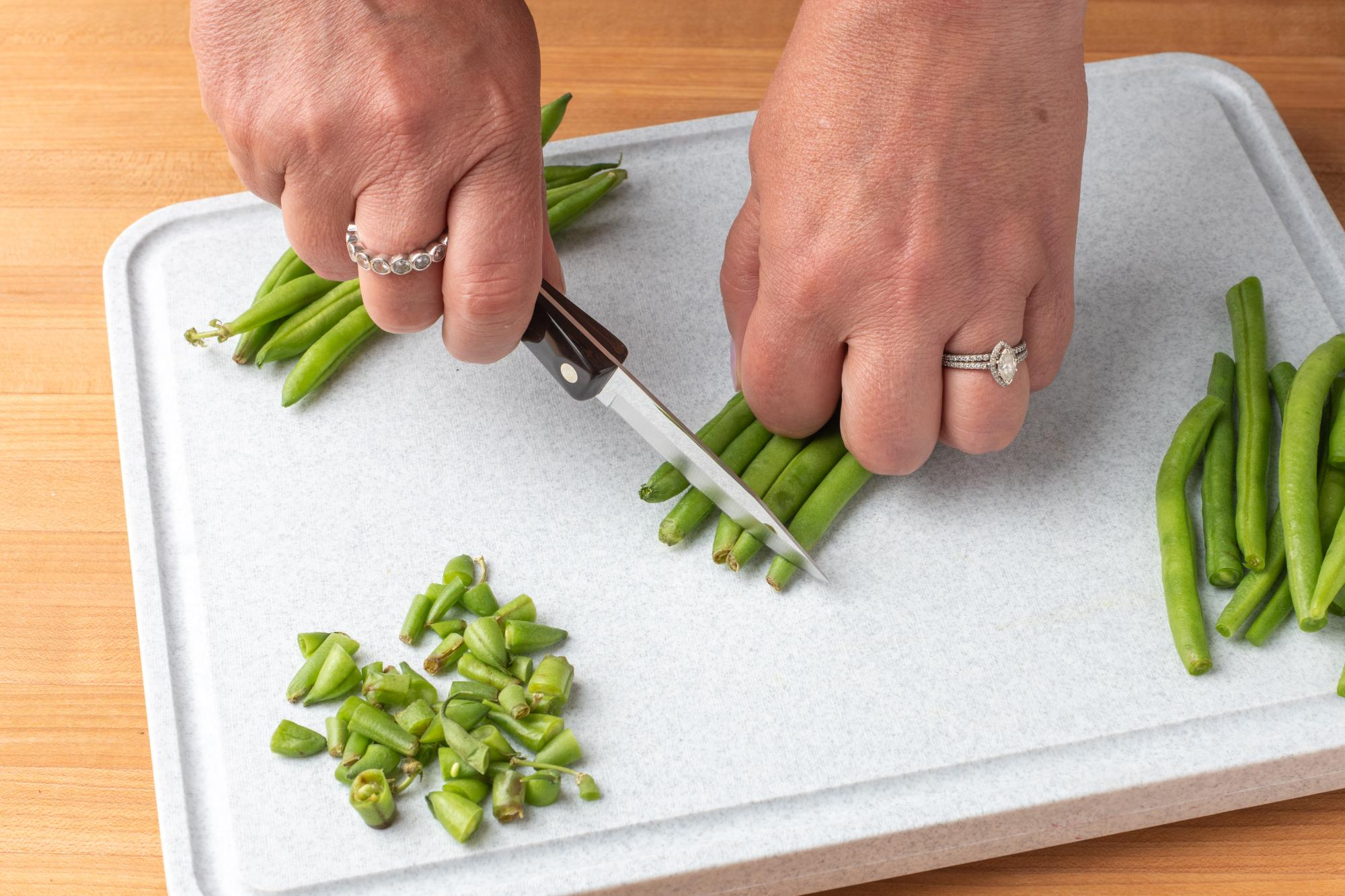 Trimming ends off the green beans.