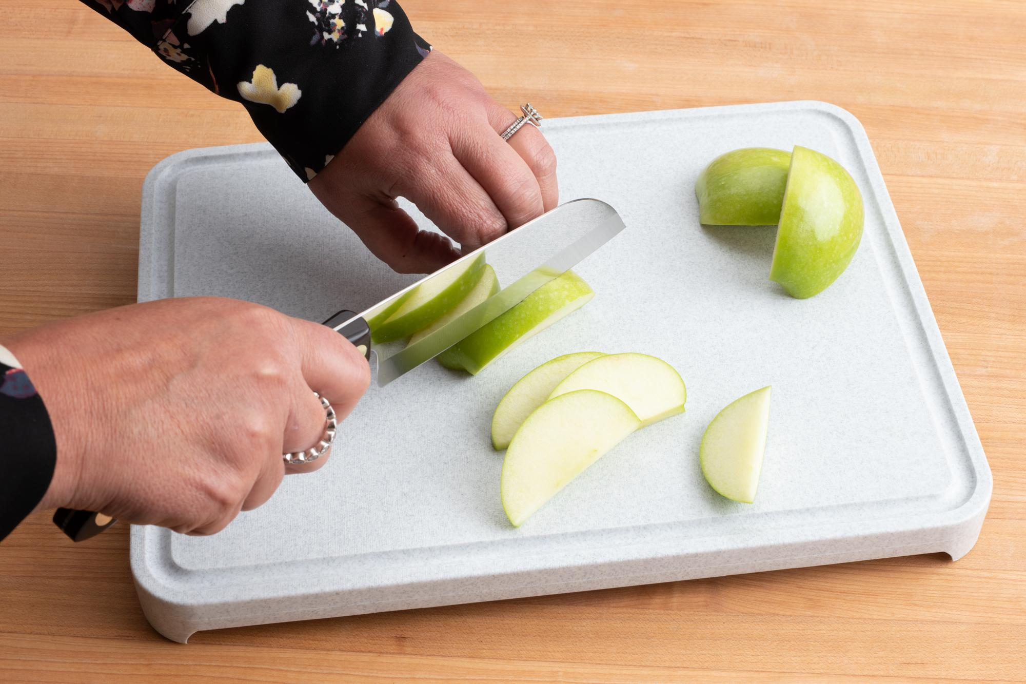 Using the Petite Santoku to thinly slice the apple.