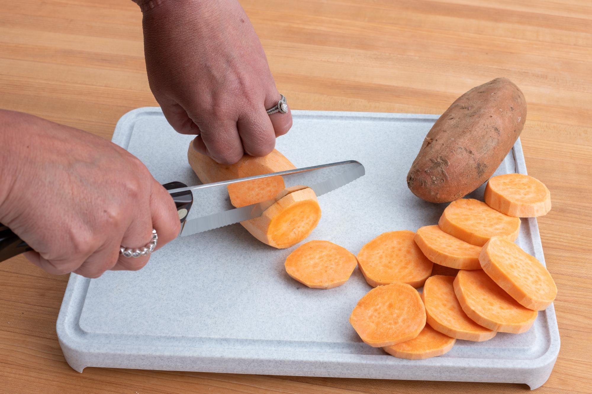 Making slices of sweet potato with the Hardy Slicer.