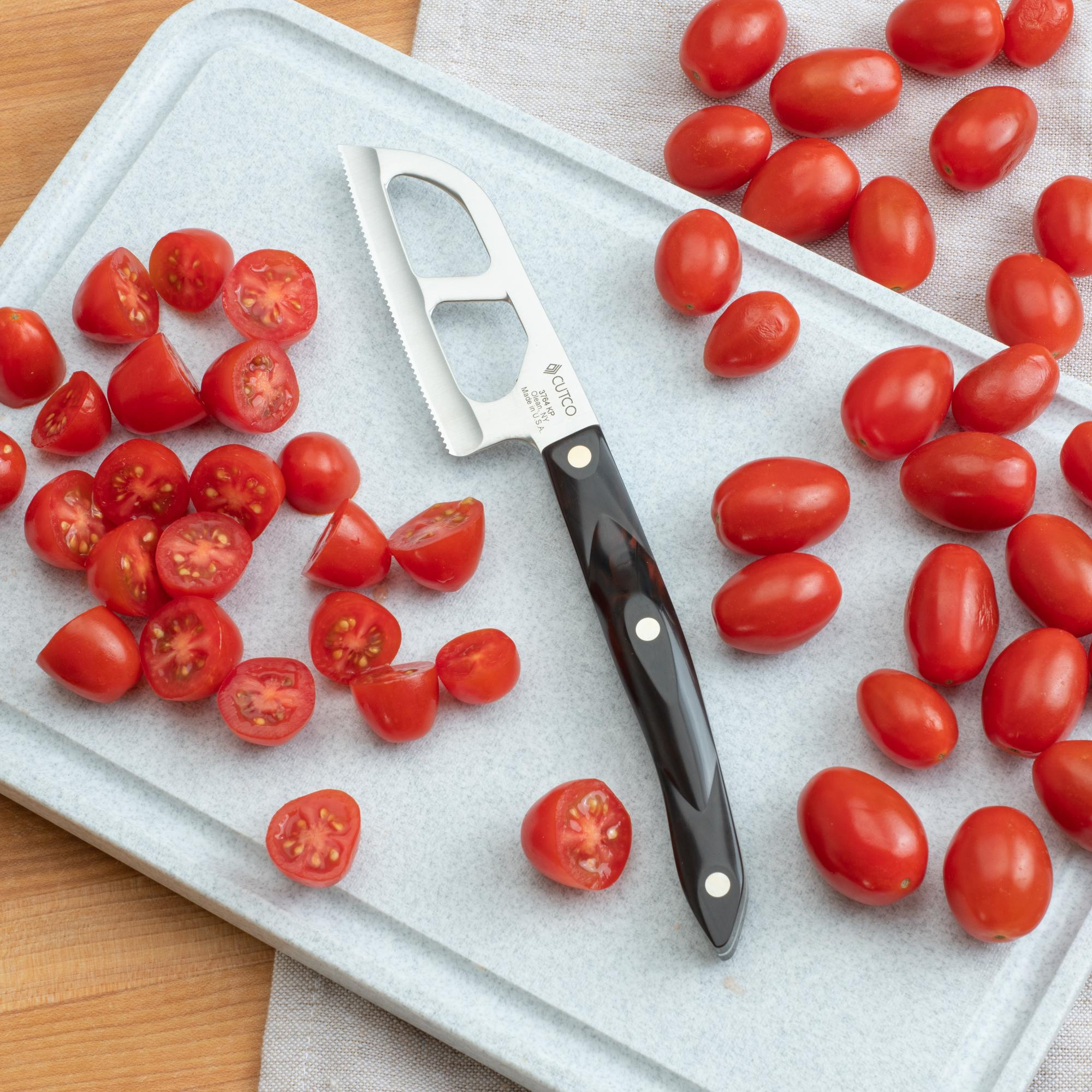 Halving the grape tomatoes with the Santoku-Style Cheese Knife.