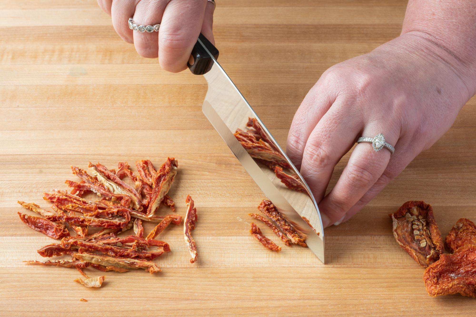 Using the Petite Santoku to slice the sun-dried tomatoes.