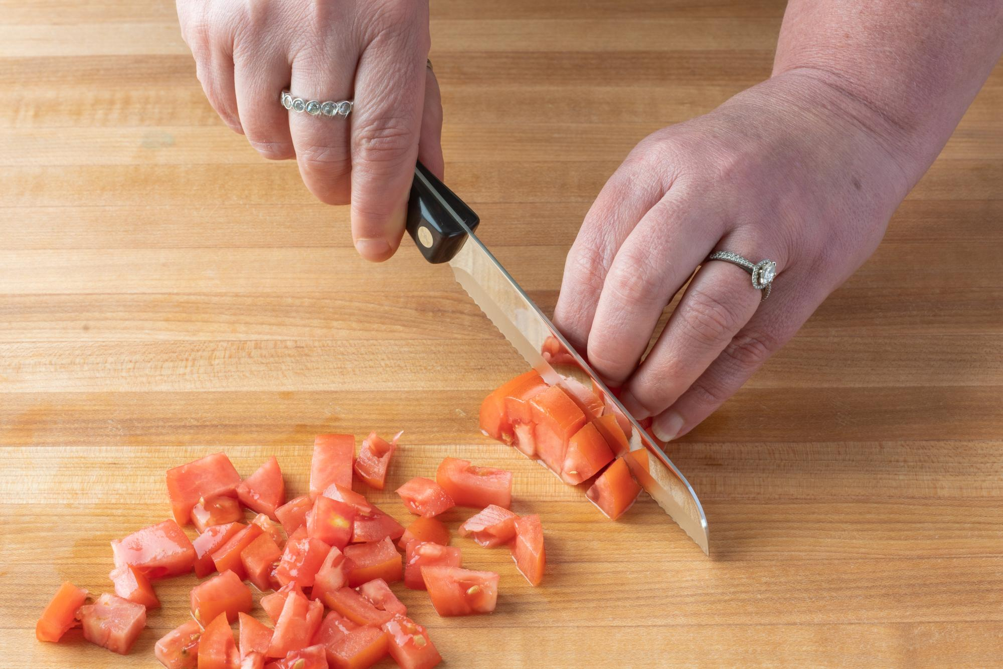 Using a Santoku-Style Trimmer to chop the tomatoes.