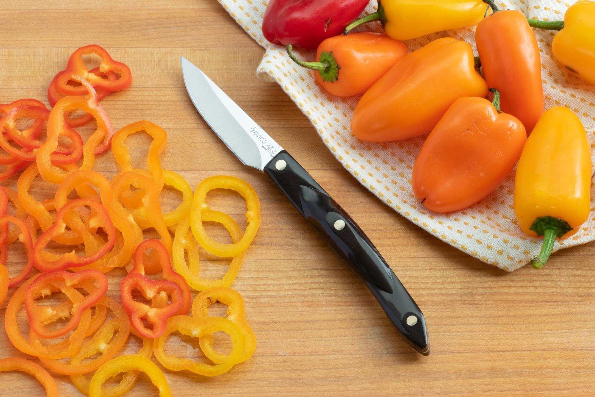 Using the 3 Inch Gourmet Paring knife to slice the mini bell peppers.