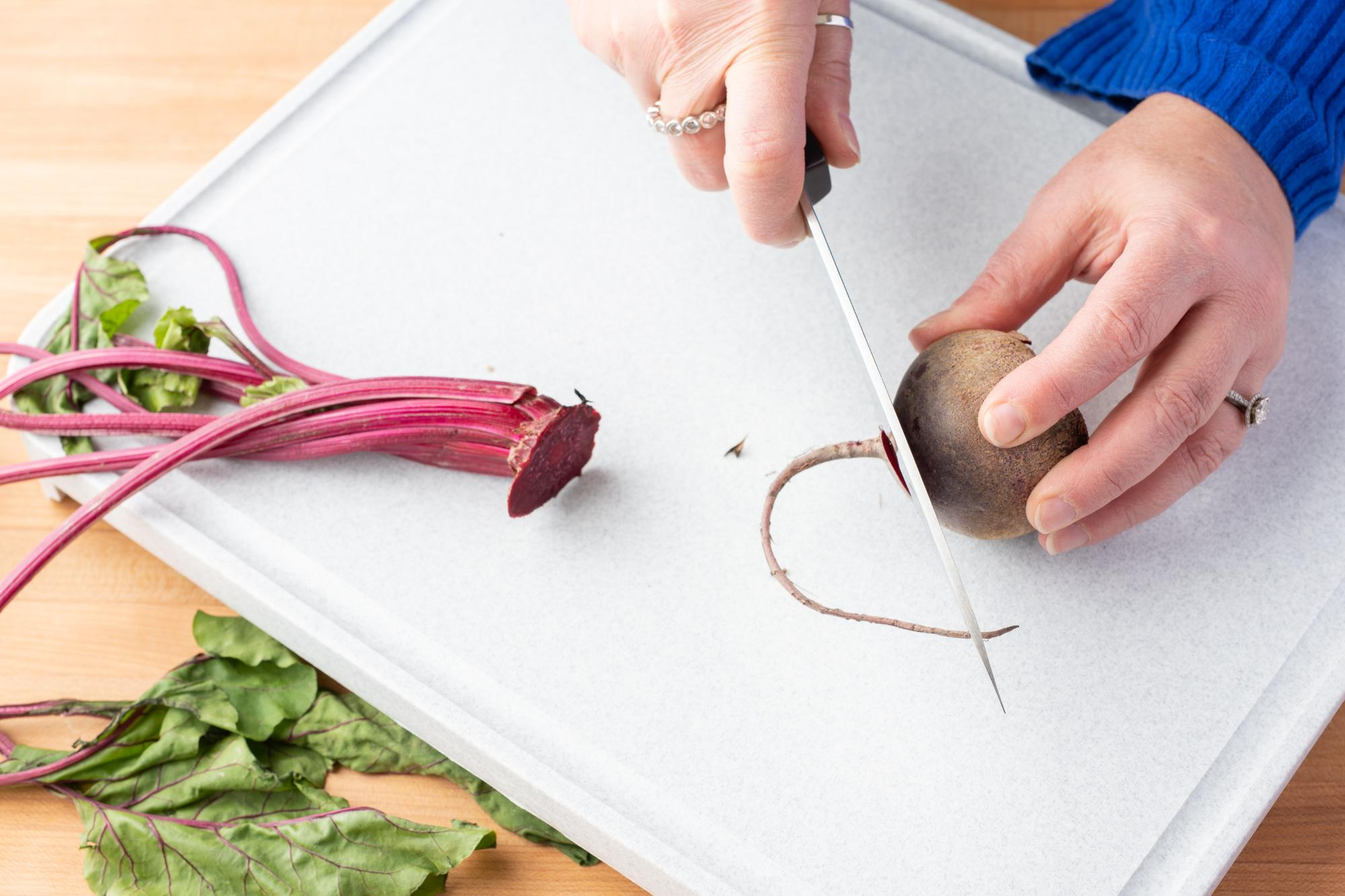 Trimming the ends of the beet with a Hardy Slicer.