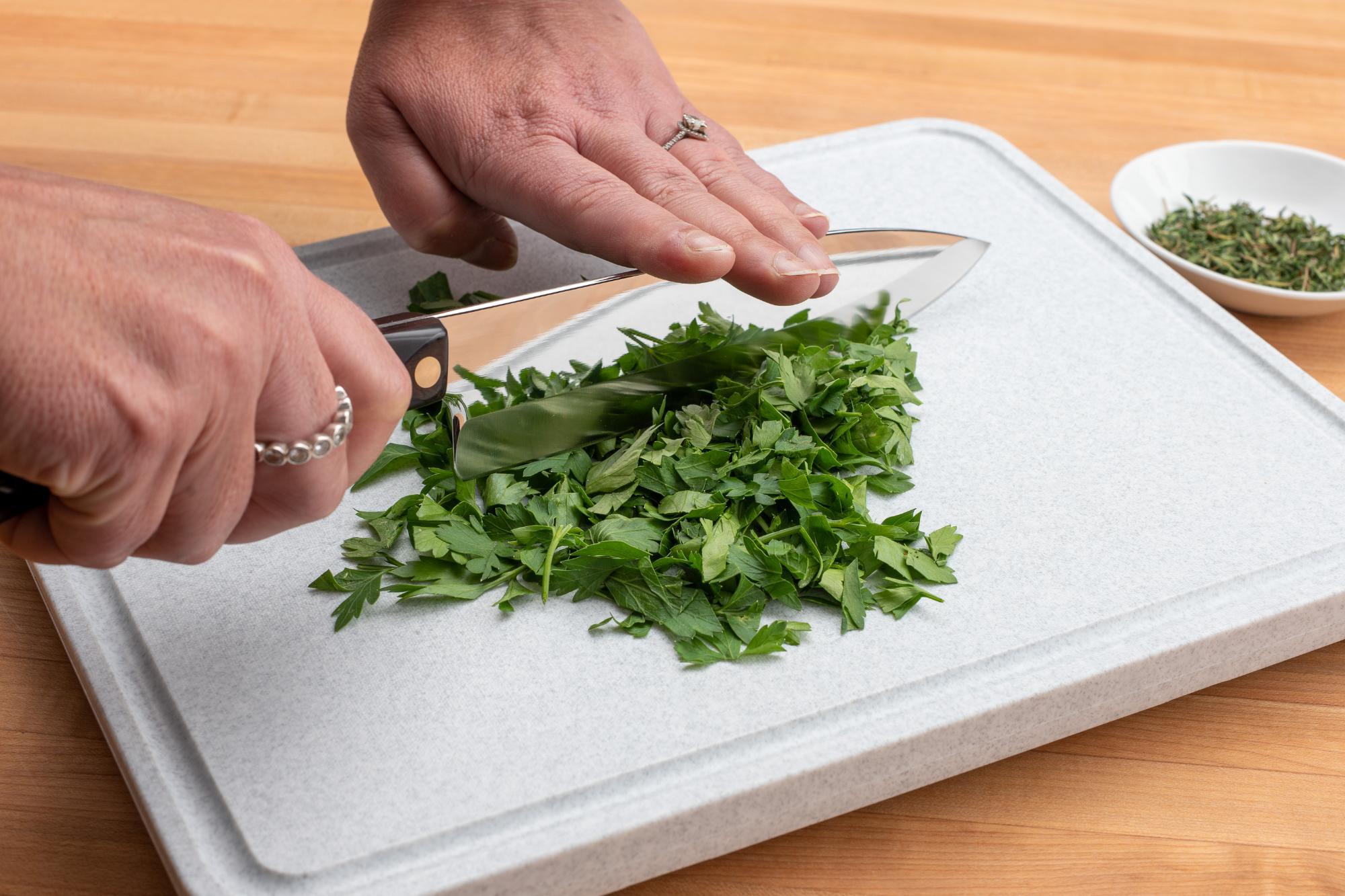 Chopping the herbs.