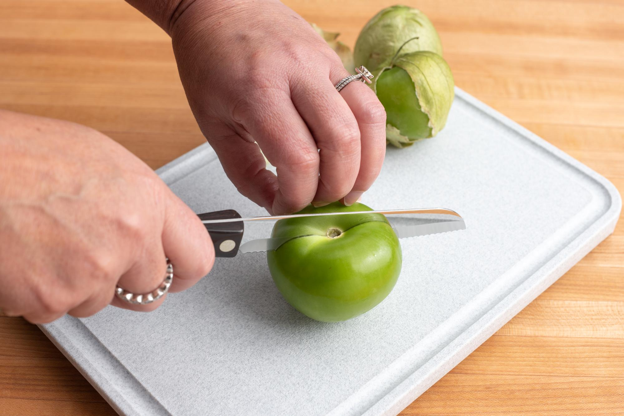 Using the Santoku-Style Trimmer to cut the tomatillos.