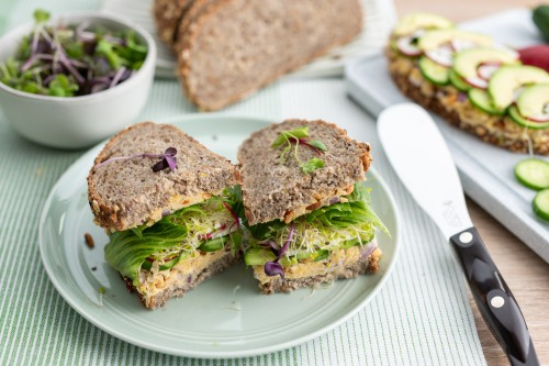 Green Sandwich with Cucumber, Avocado, Sprouts and Chickpea Spread