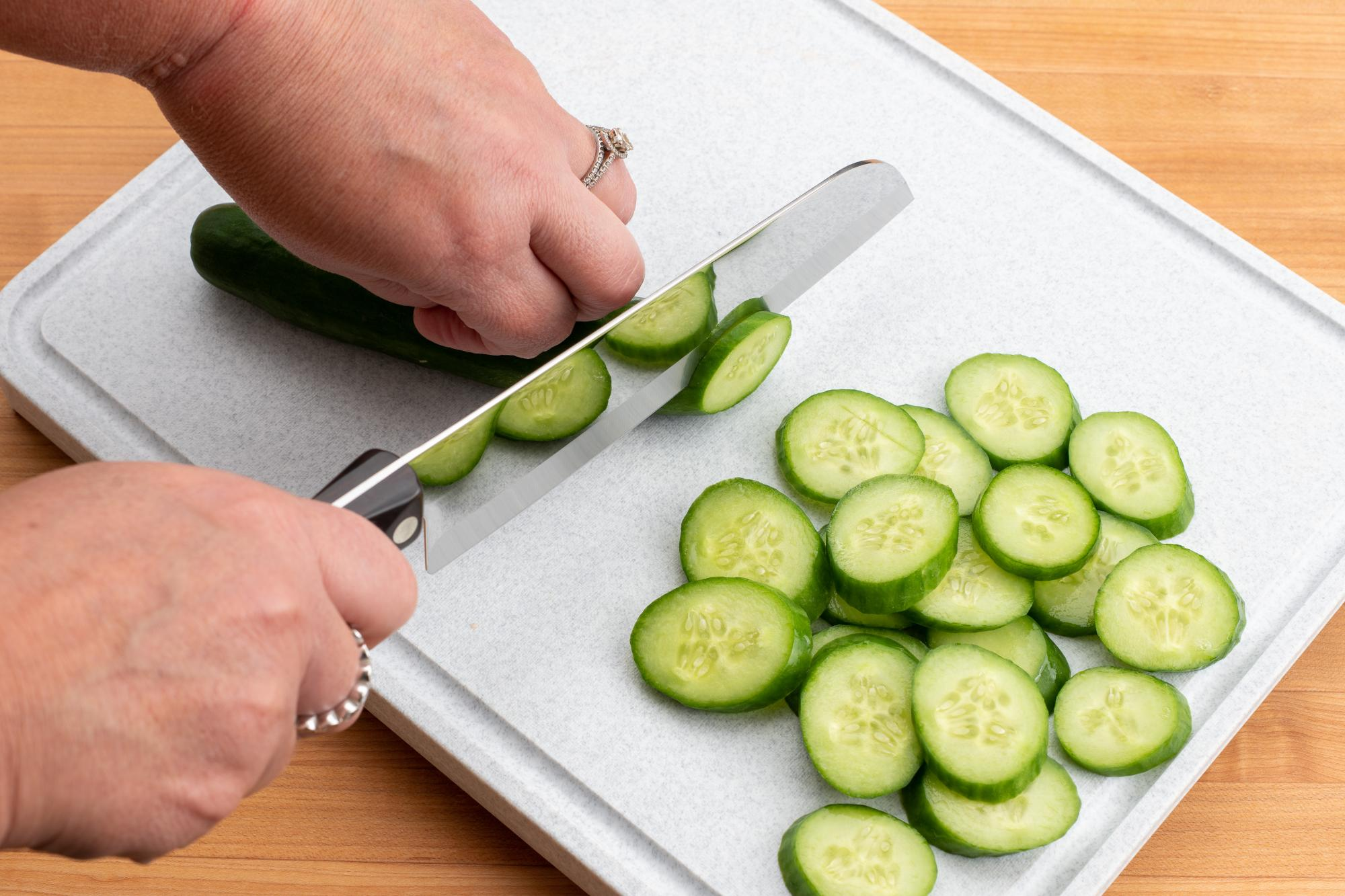 Sliced cucumber with a Santoku.