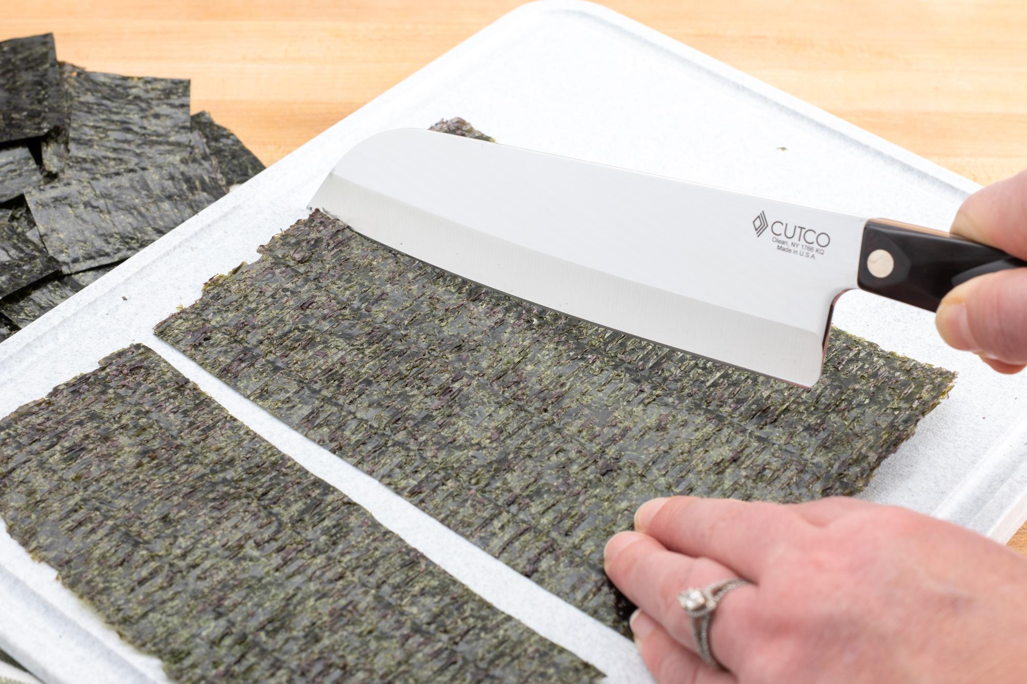Cutting nori Sheets with a Santoku.
