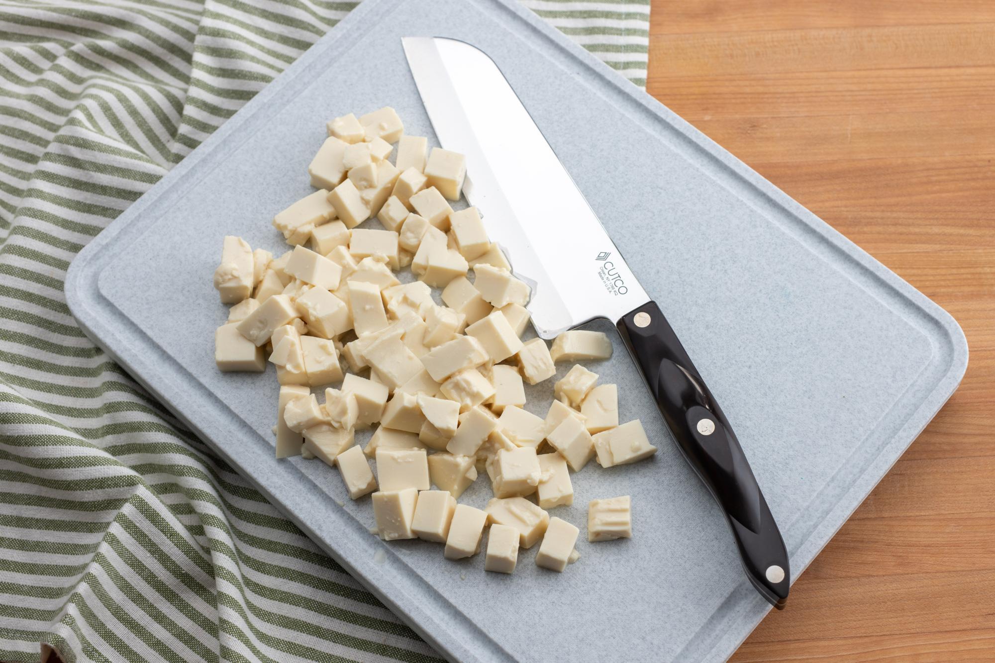 Cubed tofu with a Santoku