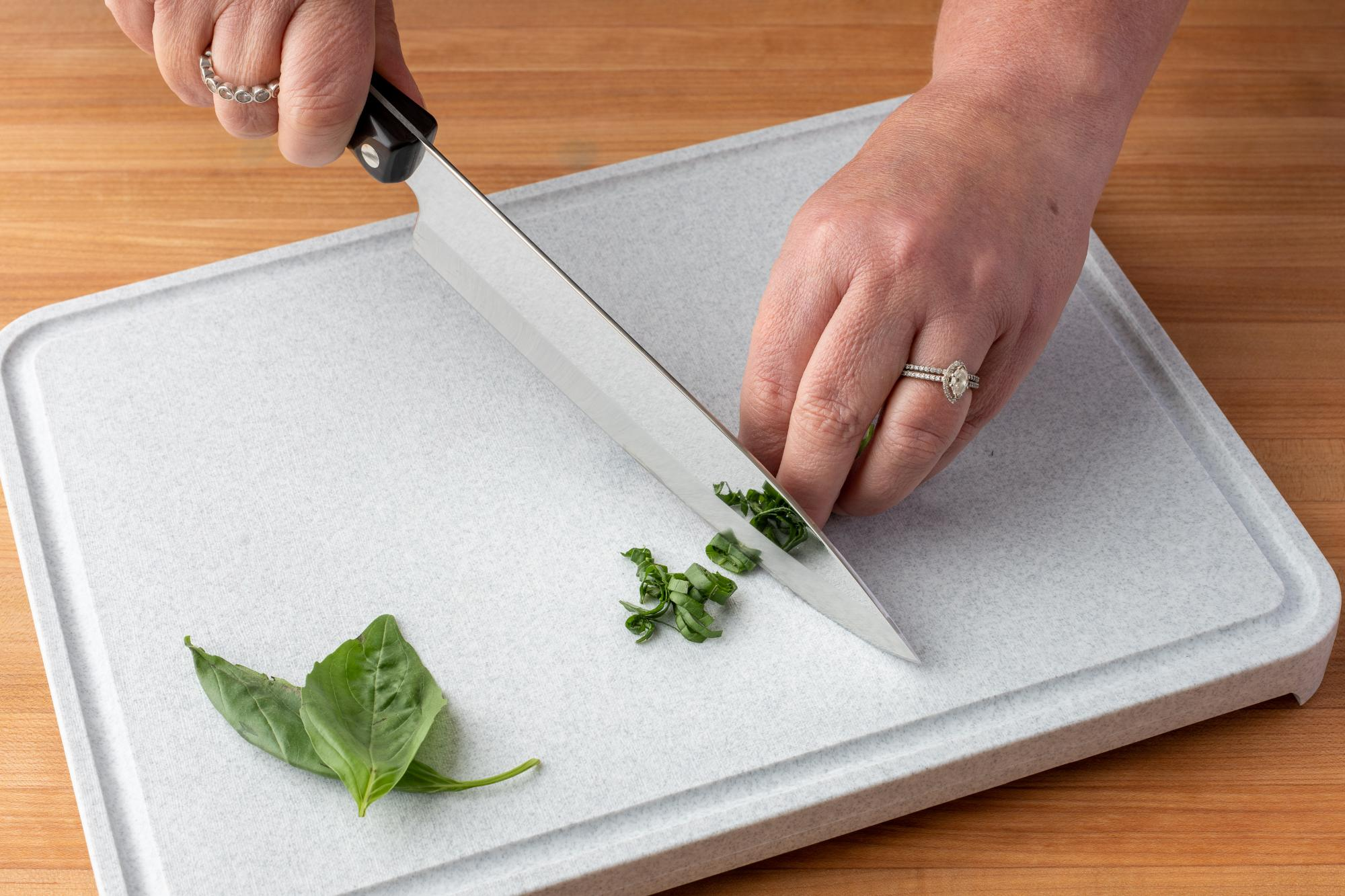 Chiffonade basil with a Petite Chef.