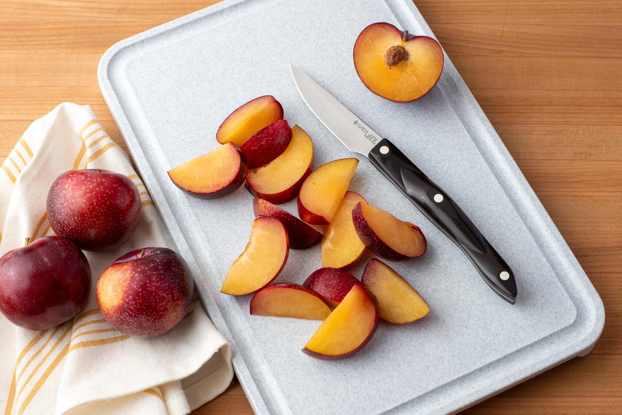 Sliced plums with the Gourmet Paring Knife.