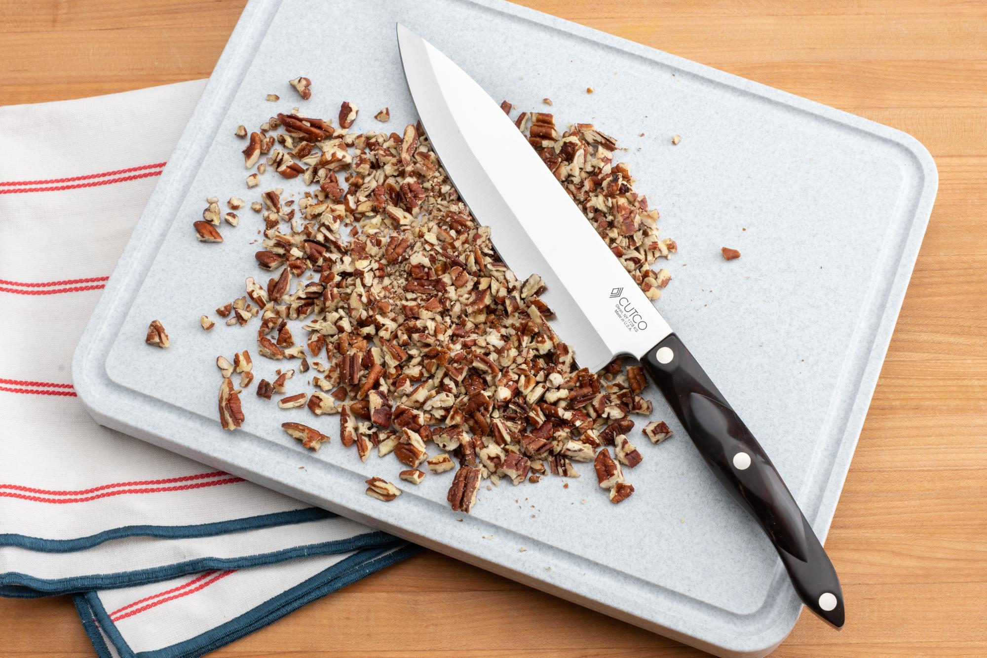 Rough-chopped pecans with the 7-5/8-Inch Petite Chef knife.