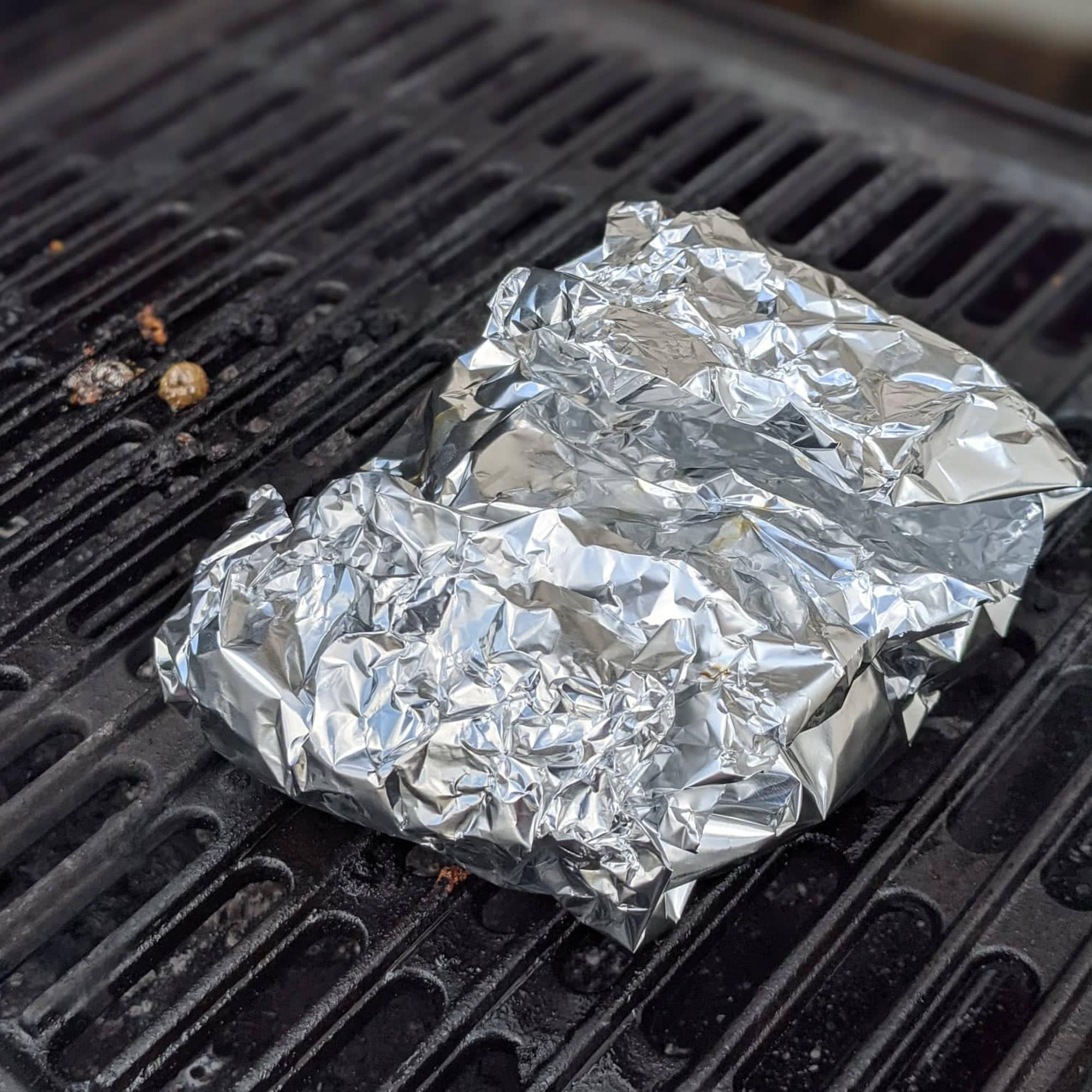 Burger wrapped in foil.