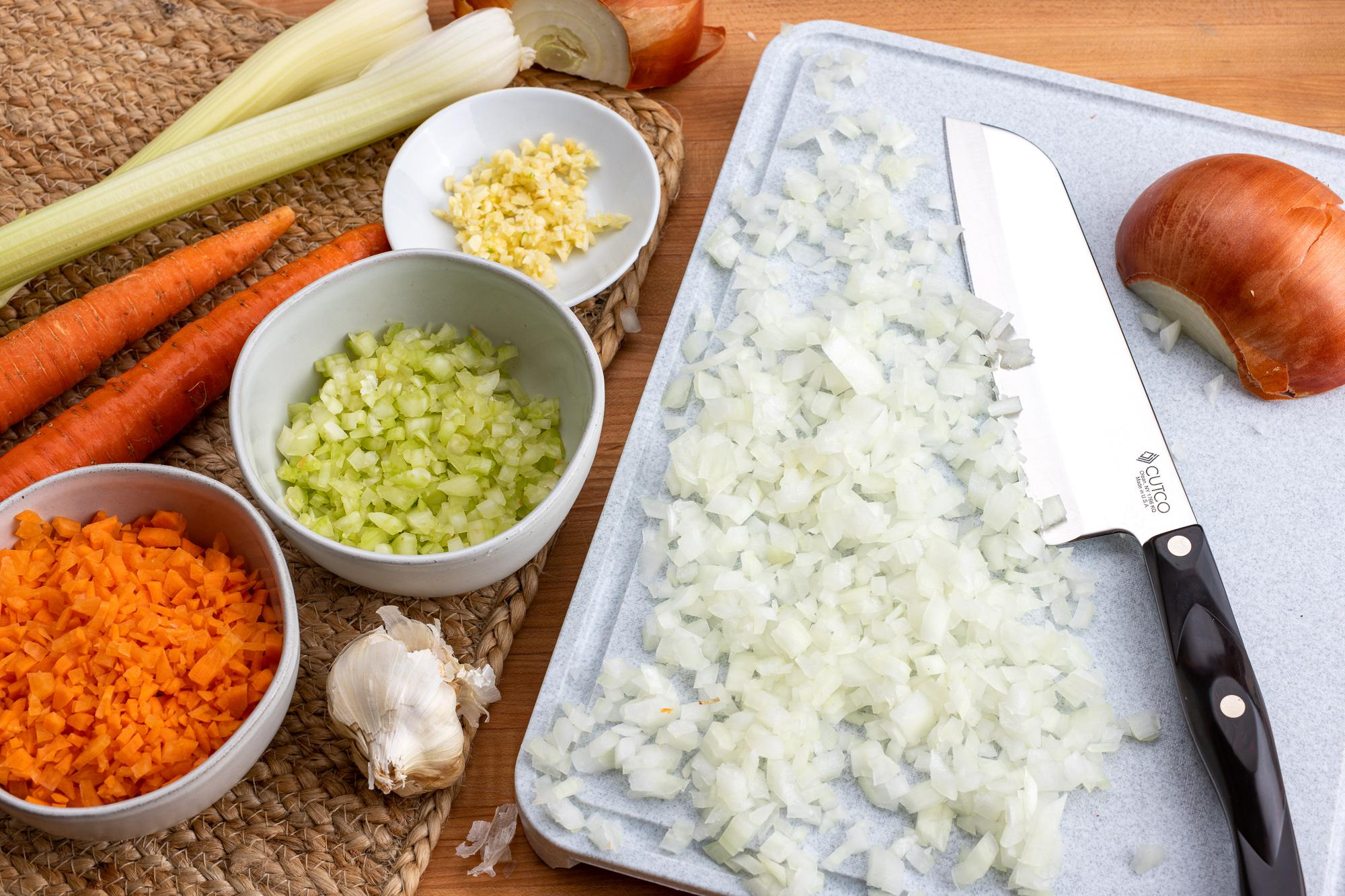 Prepped onion, celery and carrot with the Santoku.