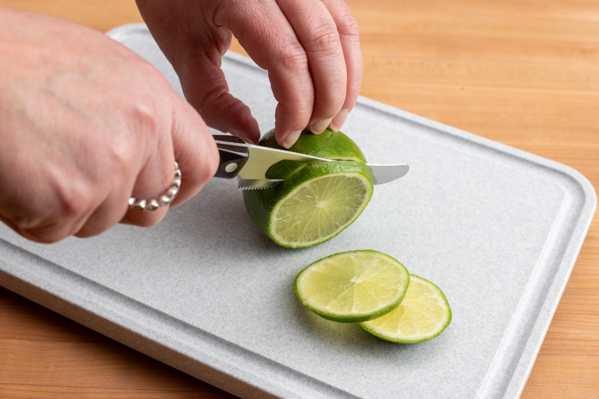 Use the Mini Cheese Knife to slice the lime.