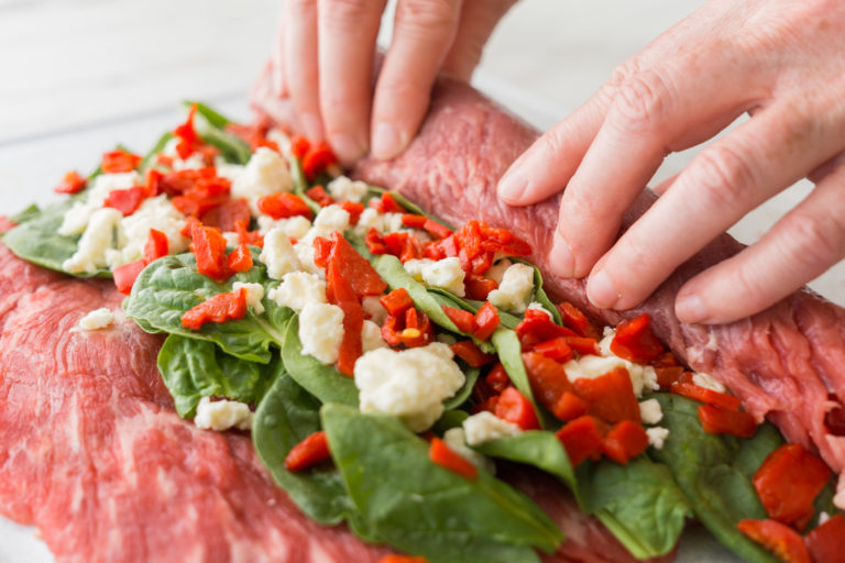 Rolling up the steak.